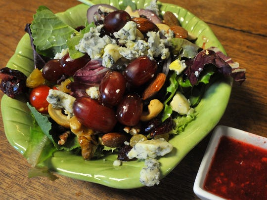 A bistro house salad prepared Monday afternoon by 319 Art Gallery and Bistro in downtown Wausau.