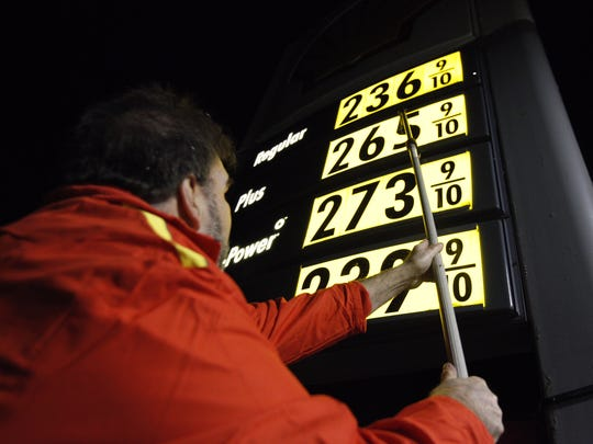Lou Franco, 57, change gas prices. Franco said they sold 1,640 gallons of gas Monday, exactly 600 gallons more than the previous Monday.