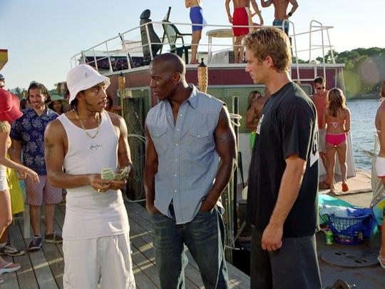 "Tej (Chris ""Ludacris"" Bridges), Roman (Tyrese Gibson and Brian (Paul Walker) take on a drug lord in ""2 Fast 2 Furious."""