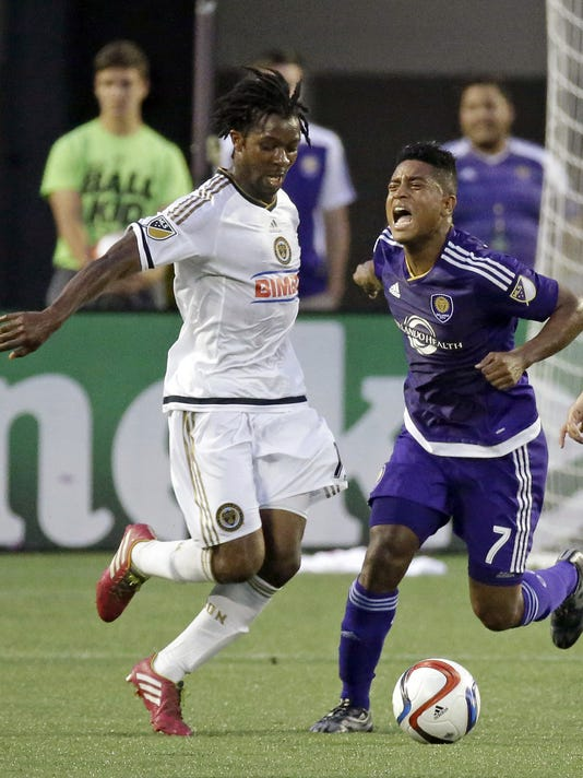 Philadelphia Union midfielder Michael Lahoud, left, makes a move to steal the ball away from Orlando City midfielder Cristian Higuita (7) during the first half of an MLS soccer game, Saturday, Aug. 8, 2015, in Orlando, Fla. (AP Photo/John Raoux)