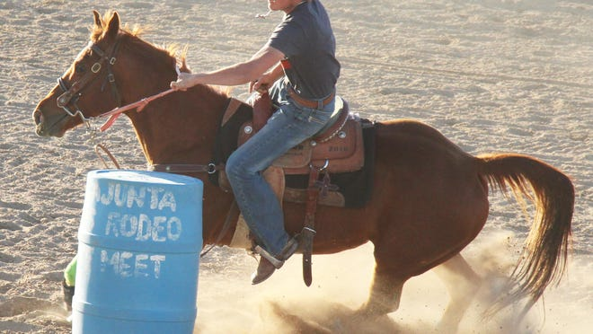 Evan Bottini rounds the final barrel in the senior boys barrel racing in the third Aces of Spades gymkhana of the season. Bottini won the event in 19.83 seconds and he also won flag racing in 8.65 seconds. KEN HAMRICK PHOTO]