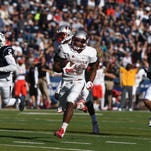 UNLV's Keith Whitely (28) breaks free for a touchdown while taking on Nevada during their game for the Fremont Cannon at Mackay Stadium in Reno on Oct. 3, 2015.