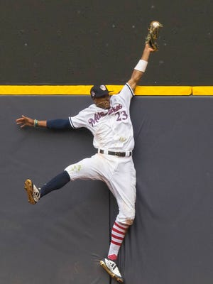 Brewers centerfielder Keon Broxton robs Brian Dozier of the Twins of a home run with a leaping catch against the wall in deep center during the ninth inning on Wednesday.