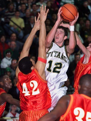 Boylan's Joe Tulley (12), the NIC-9 MVP in 2009, shoots over Jefferson's Clarence Harris (42), Kevin Lambert (35) and Adam Peck in Boylan's 50-43 overtime victory in the 1999 Class AA sectional title game.