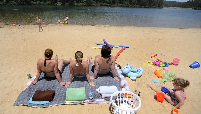 Visitors to Oak Mountain State Park enjoy the beach. The park may get a luxury hotel.