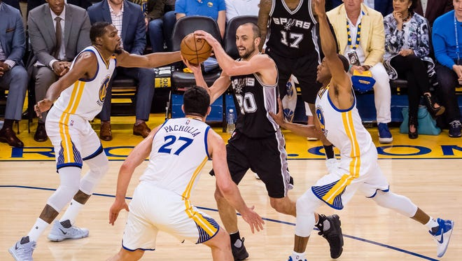 San Antonio Spurs guard Manu Ginobili controls the ball between Golden State Warriors forward Kevin Durant center Zaza Pachulia and forward Andre Iguodala during the second quarter in game one of the Western Conference finals.