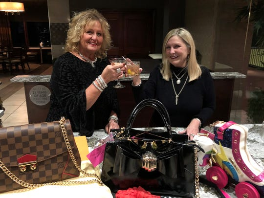 The Queen and Betsey – Since the first Go Red Luncheon five years ago, good friends Cynthia Wolfe and Kat Sanders have supported the event with wonderful purse selections for the event. For the 5th year, Cynthia has graciously donated another Louis Vuitton bag, dubbed The Queen by the committee. Kat's fun roller skate bag is a sweet creation by Betsey Johnson and includes extras for a special package. Over 60 bags will complement the silent auction event, raising funds for the American Heart Association.