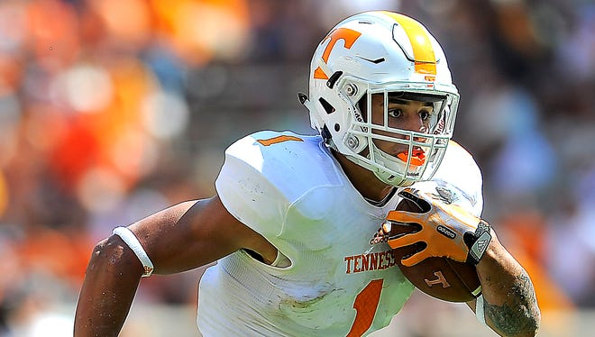 Jalen Hurd (1) looks down the field as he runs as the University of Tennessee plays in the Orange and White game at Neyland Stadium. Saturday April 12, 2014, in Knoxville, TN.