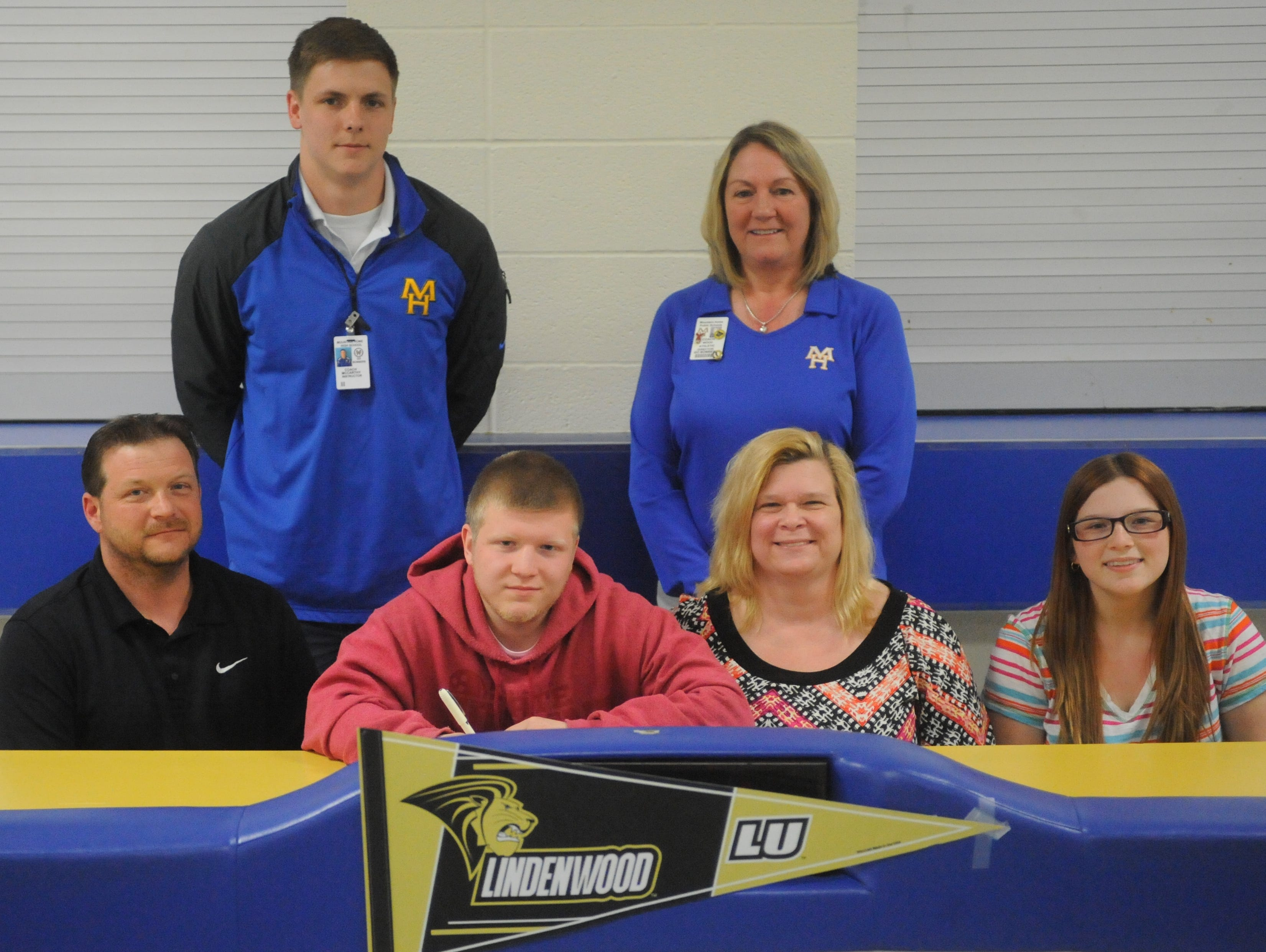 Mountain Home's Troy Kill signed a National Letter of Intent on Monday to bowl at Lindenwood University at St. Charles, Mo. Shown at the signing ceremony are: first row, from left, Kill's father, John Kill; Kill; Kill's mother, Tricia Kill; Kill's sister, Caitlyn Kill; second row, Mountain Home High School bowling coach Chaseton McCarthy; and Mountain Home High School athletics director Janet Wood.