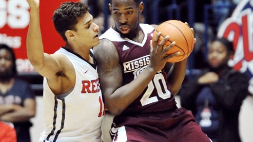 """Mississippi State Bulldogs forward Gavin Ware (20) works against Mississippi Rebels forward Sebastian Saiz (11) during the NCAA basketball game at the C.M. """"Tad"""" Smith Coliseum in Oxford, Miss. on Wednesday, Jan.28, 2015. Mississippi won 79-73. (AP Photo/Oxford Eagle, Bruce Newman) no sales"""