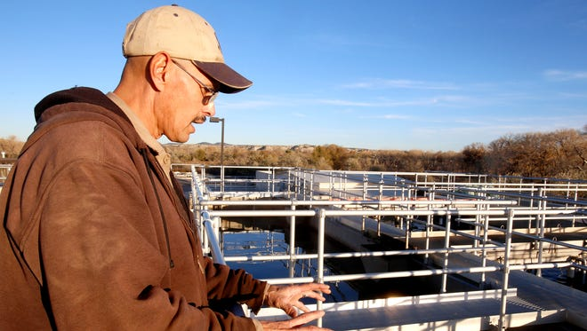 Plant operator Anthony Garcia talks on Thursday about equipment at the Aztec Wastewater Treatment Plant.