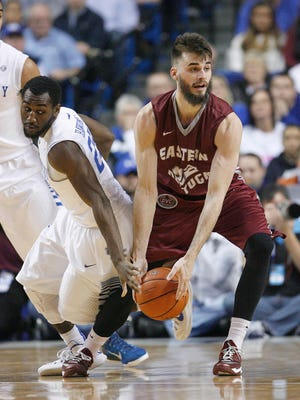 Dec 7, 2014; Lexington, KY, USA; Kentucky Wildcats guard Dominique Hawkins (25) reaches for the ball against Eastern Kentucky Colonels guard Timmy Knipp (22) in the second half at Rupp Arena. The Kentucky Wildcats  defeated the Eastern Kentucky Colonels 82-49. Mandatory Credit: Mark Zerof-USA TODAY Sports