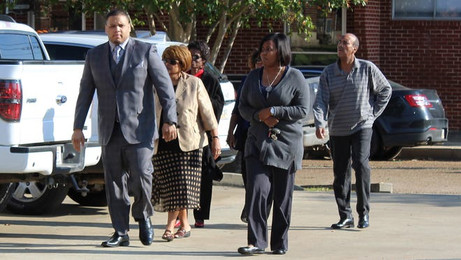 Derrick Stafford, left, walks to the Avoyelles Parish Courthouse on Wednesday, Sept. 28, 2016, with his wife, Brittany Stafford, and other family members. Stafford, a former police officer, is charged with second-degree murder and attempted second-degree murder.