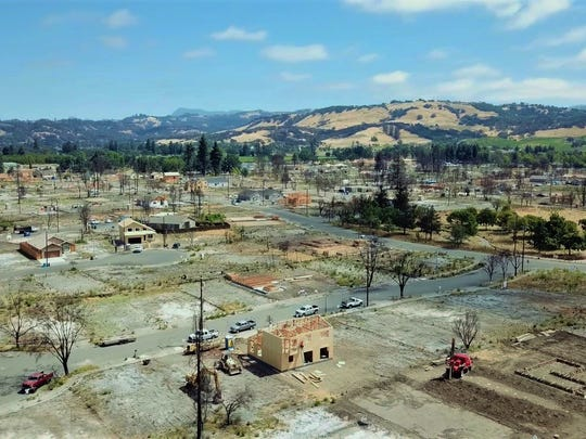 A city reborn, if slowly: The Coffey Park neighborhood of Santa Rosa, which was nearly obliterated by the fires last October, now shows signs of rebirth as a few homeowners move back into new homes.