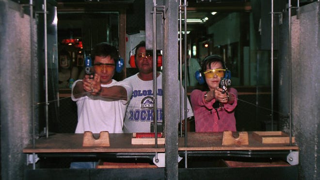 Customers try their hands at firearms at the Western Frontier Village in Tumon.