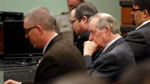 Eric Williams, center, listens during victim impacts statements after he was sentenced to death in his capital murder trial at the Rockwall County Courthouse, Wednesday, Dec. 17, 2014, in Rockwall, Texas.  The former justice of the peace in North Texas was sentenced to death for killing a district attorney's wife in what prosecutors described as a revenge plot that left three people dead. He was convicted Dec. 4 of capital murder in the 2013 death of Cynthia McLelland, who was slain along with her husband, Kaufman County District Attorney Mike McLelland, in their home east of Dallas. Williams has been charged, but not tried, in the deaths of Mike McLelland and prosecutor Mark Hasse. (AP Photo/The Dallas Morning News, Vernon Bryant, Pool)