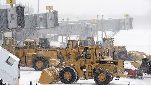 Plows line up at airplane gates as Bradley International Airport remains closed during a snowstorm, Tuesday, Jan. 27, 2015, in Windsor Locks, Conn. A major winter storm dropped a foot of snow or more over much of Connecticut, hitting hardest in the eastern part of the state.