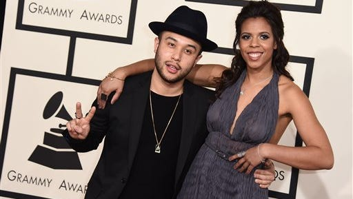 Jax Jones, left, and Kelli Leigh arrive at the 57th annual Grammy Awards at the Staples Center on Sunday, Feb. 8, 2015, in Los Angeles.
