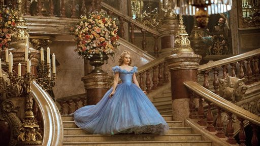 "This image released by Disney shows Lily James as Cinderella in Disney's live-action feature inspired by the classic fairy tale, ""Cinderella."""