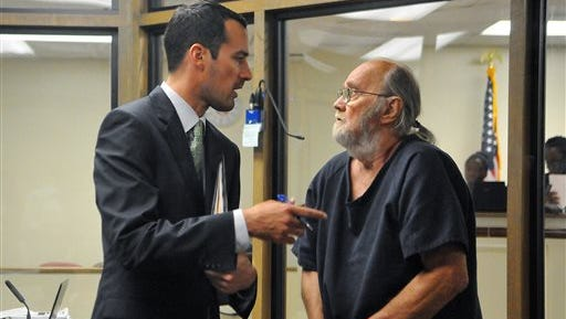 FILE- In this Thursday, May 14, 2015 file photo, attorney Bryan Savy speaks with his client Frank Freshwaters during a court hearing at the Brevard County Jail, in Cocoa, Fla.   Freshwaters' sentence was recalculated based on his time at large and in custody to determine that he'll have a hearing in August on the issue of possible parole, Ohio Department of Rehabilitation and Correction spokeswoman JoEllen Smith said Wednesday, May 27, 2015. (Craig Rubadoux/Florida Today via AP, File)  NO SALES, MAGS OUT