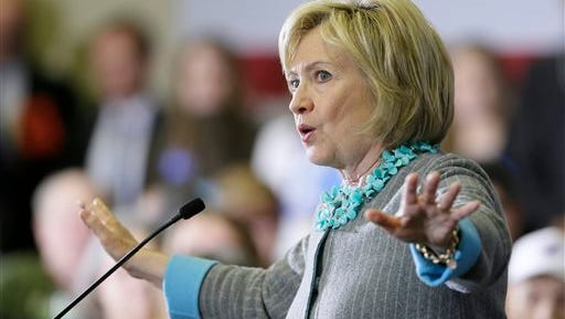 """In this Dec. 9, 2015, photo, Democratic presidential candidate Hillary Clinton speaks during a town hall meeting in Waterloo, Iowa. Clinton had just finished detailing the dangers of terrorism, recalling tough calls in the White House situation room as secretary of state and lashing out at her Republican rivals for threatening the safety of Americans. But when an Iowa man broke into her riff with a question about how the country could confront a new wave of hate and fear, her response sounded less like that of a commander in chief than of a soothing self-help guru. """"We've got to do everything we can to weed out hate and plant love and kindness,"""" she told a crowd of several hundred."""