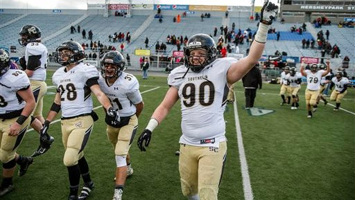 Southern Columbia's Chase Tillett (90) celebrates his team's victory over Aliquippa in the PIAA Class AA football championship, Saturday in Hershey. Southern Columbia defeated Aliquippa 49-14.