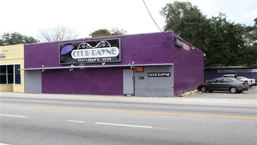 This Saturday photo shows the outside of  Club Rayne in Tampa, Fla. A shooting at the strip club early Saturday morning left one person dead, seven injured.  Police are investigating the motive for the shooting.