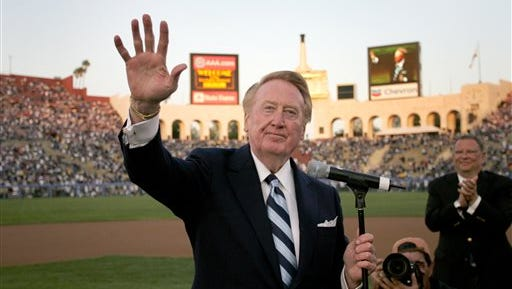 In this March 29, 2008, file photo, Los Angeles Dodgers announcer Vin Scully waves to the crowd during a ceremony honoring him before the start of an exhibition baseball game between the Los Angeles Dodgers and Boston Red Sox at the Los Angeles Coliseum. Vin Scully will be behind the mic for the final home opener of his 67-year career when the Los Angeles Dodgers host the Arizona Diamondbacks on Tuesday, April 12, 2016.