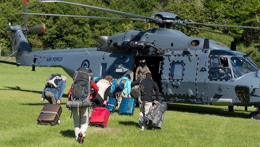 In this image provided by the Royal New Zealand Defense Force, tourists are evacuated by helicopter from Kaikoura following Monday's earthquake, in New Zealand, Tuesday, Nov. 15, 2016. New Zealand military officials said Tuesday that they had evacuated about 140 people by helicopter from a coastal town and were expecting that number to rise to 200 by the end of the day, as a major rescue operation unfolded following a powerful earthquake.
