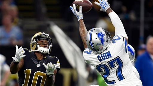 Detroit Lions free safety Glover Quin (27) tries to break up a pass intended for New Orleans Saints wide receiver Brandin Cooks (10) in the second half of an NFL football game in New Orleans, Sunday, Dec. 4, 2016. (AP Photo/Bill Feig)