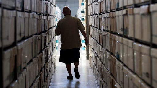 Boxes of California inmate medical records are stored at a facility in Sacramento. A massive project to computerize the prison system's antiquated paper-based medical record-keeping for the nearly 130,000 inmates has doubled in cost from the original estimates to nearly $400 million. (AP Photo/Rich Pedroncelli)