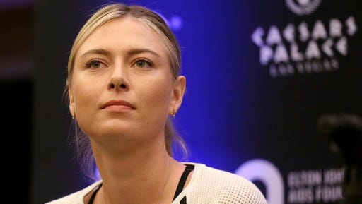 FILE - In this Monday, Oct. 10, 2016 file photo, Maria Sharapova speaks to members of the media prior to a World Team Tennis exhibition in Las Vegas, U.S. Sharapova will return from her 15-month doping ban at a tournament in Germany in April.