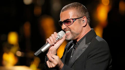 "FILE - In this Sept. 9, 2012 file photo, British singer George Michael in concert to raise money for AIDS charity Sidaction, in Paris, France. George Michael's spokeswoman says the singer is ""resting"" after receiving hospital treatment for an undisclosed ailment. The Grammy Awards announced Wednesday Feb. 8, 2017, that Sunday's show will include tribute performances in honor of Prince and George Michael. Both stars died last year."