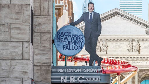 """This undated photo made available by Universal Orlando Resort, shows the new """"Race Through New York Starring Jimmy Fallon"""" ride in Orlando, Fla. Universal is leading the theme-park charge into """"virtual lines"""" that give visitors options for exploring a park or watching live entertainment instead of the tedium of looking at someone's back as you inch forward step by step to the thrill ride."""