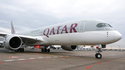 FILE- In this Jan. 15, 2015, file photo, a new Qatar Airways Airbus A350 approaches the gate at the airport in Frankfurt, Germany. As the indignities of modern air travel go, the latest ban on laptops and tablets on some international flights falls somewhere between having to take off your ratty shoes at the security checkpoint and having your baby food and milk tested for bomb residue. It's yet another inconvenience in the name of security for weary travelers, especially those from or passing through the 10 mostly Middle Eastern and North African countries covered by new U.S. and British policies.
