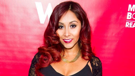"FILE - In this May 29, 2014 file photo, Nicole ""Snooki"" Polizzi attends WE tv's ""Marriage Boot Camp: Reality Stars"" party in New York. Under legislation inspired by former ""Jersey Shore"" reality TV star Polizzi, no more than $10,000 of state money could go to pay speakers at New Jersey's public universities. The Democrat-controlled Assembly is scheduled to vote on the bill Thursday, March 23, 2017."
