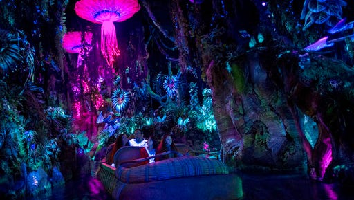 "This photo provided by Disney shows guests in the ""Na'vi River Journey,"" part of the new land opening at Walt Disney World's Animal Kingdom in Lake Buena Vista, Fla., on May 27, 2017, called ""Pandora - The World of Avatar."" The land was inspired by the lush world of Pandora depicted in the movie ""Avatar."""