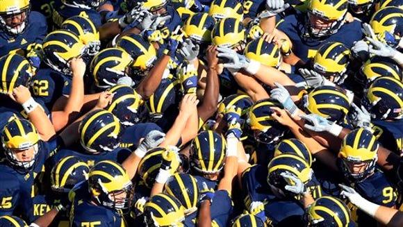 Michigan huddle AP