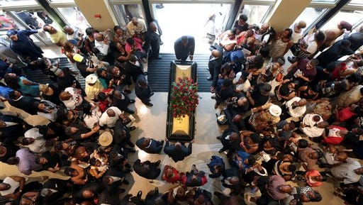 FILE - In this Monday, Aug. 25, 2014, file photo, a casket containing the body of Michael Brown is wheeled out of Friendly Temple Missionary Baptist Church in St. Louis. Hundreds of people gathered to say goodbye to Brown, who was shot and killed by a Ferguson, Mo., police officer on Aug. 9. (AP Photo/St. Louis Post Dispatch, Robert Cohen, Pool, File)