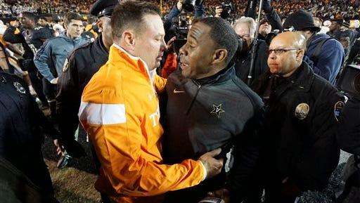 Vanderbilt head coach Derek Mason, front right, congratulates Tennessee head coach Butch Jones after an NCAA college football game in Nashville, on Nov. 29.