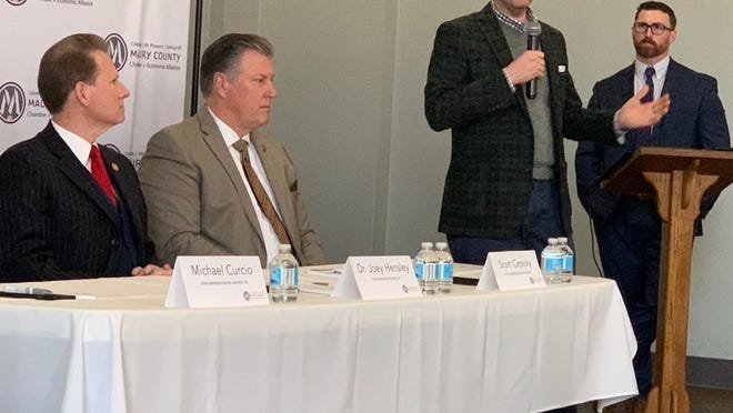State Rep. Michael Curcio (R-Dickson), right, speaks at Friday's State Eggs & Issues breakfast at The Memorial Building in Columbia. He is joined by State Sen. Joey Hensley (R-Hohenwald) and State Rep. Scott Cepicky (R-Columbia).