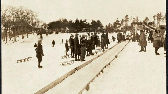 People enjoy the toboggan slide on Schoolmaster's Hill in Franklin Park on Feb. 22, 1923. Learn more from Digital Commonwealth at www.digitalcommonwealth.org.