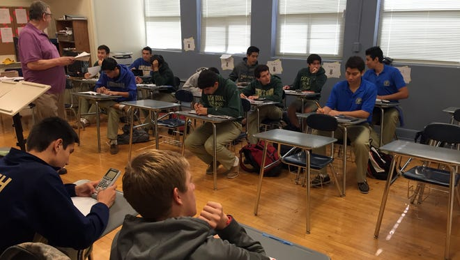 Cathedral High School students work on an assignment in a math class.