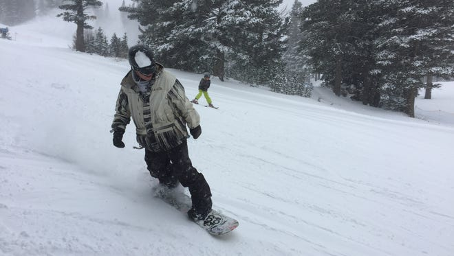 A snowboarder at Mt. Rose Ski Tahoe in Reno enjoys a powder day. A storm dumped as much as 15 inches on the resort just in time for Thanksgiving weekend. Nov. 25, 2015.