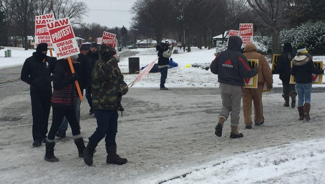 Workers picket auto supllier Ground Effects in Dearborn on Tuesday, March 2, 2016.