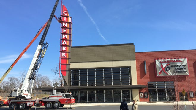 Cinemark Christiana and XD general manager Ron Landry speaks with security as crews work to repair the theater's sign.