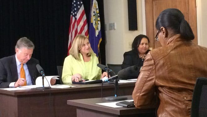 Mayor Megan Barry talks to officials from Metro Nashville Public Schools during Thursday's budget hearing next to Chief Operating Officer Rich Riebeling, left, and Metro Finance Director Talia Lomax-O'dneal.