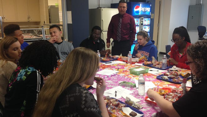 Kurt Himstedt, food service director, meets with Millville High School students to conduct a tasting of whole grain breakfast and snack items.