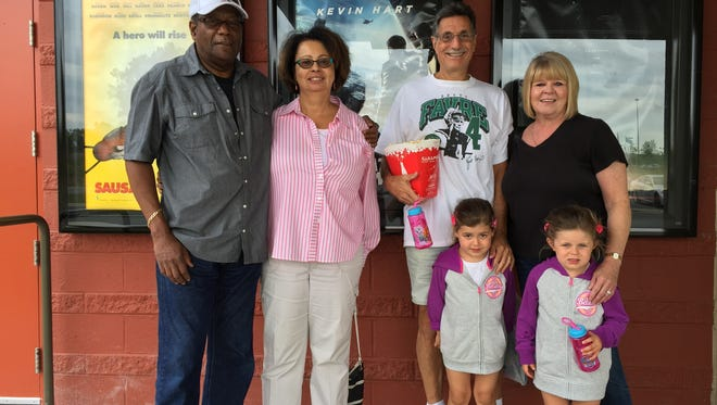 (l to r) Joe and Lynda Montgomery  of Middletown and their friends, Larry and Lynn Calandro of Hockessin and the Calandro's grandaughters, Gianna and Gabrielle. They all attended movies at the Cinemark Christiana on Thursday.