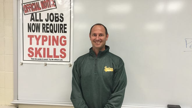 Matt Schifano, one of five teachers nominated by the National Association for Alternative Certification for Outstanding New Educator, poses in his classroom.